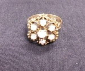J - 18K Gold Ring with Seven Stones