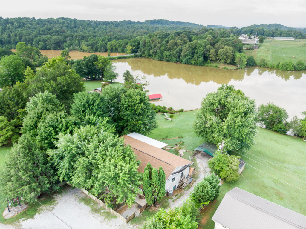REAL ESTATE AUCTION – Multi-Purpose Lakefront Property